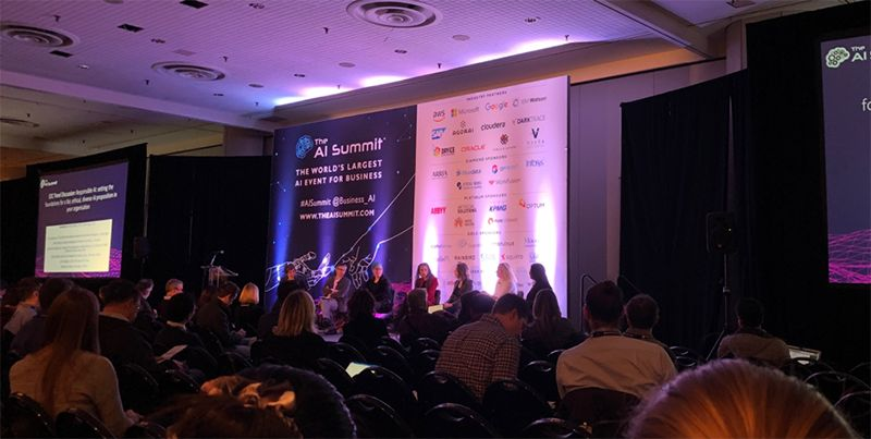 Photo of speaker panel at 2018 AI Summit in Chicago