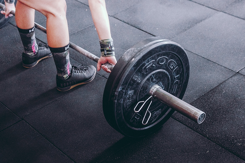 Image of person lifting a barbell