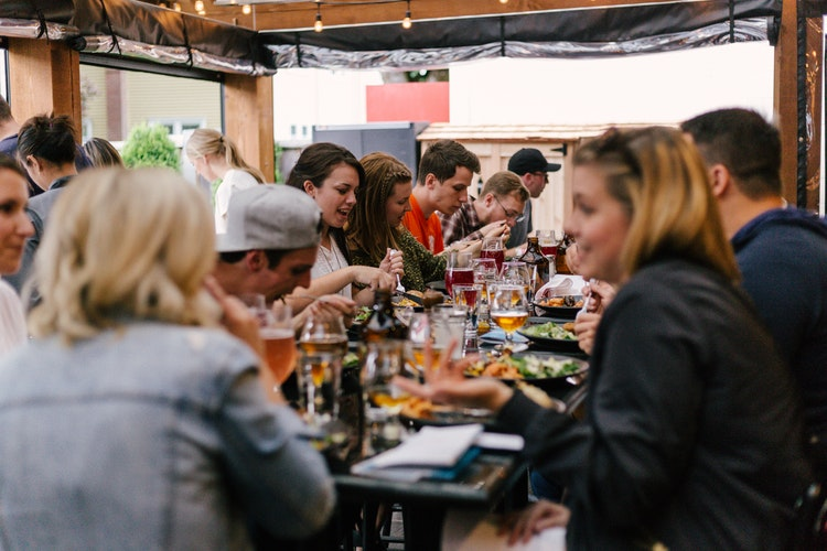 people eating and drinking at a table