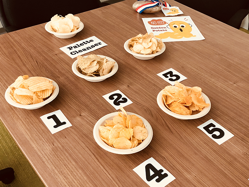 Photo of five kinds of potato chips in bowls