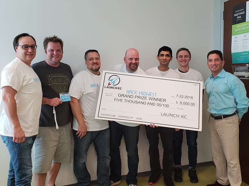 Photo of team from Intouch holding $5K winning check