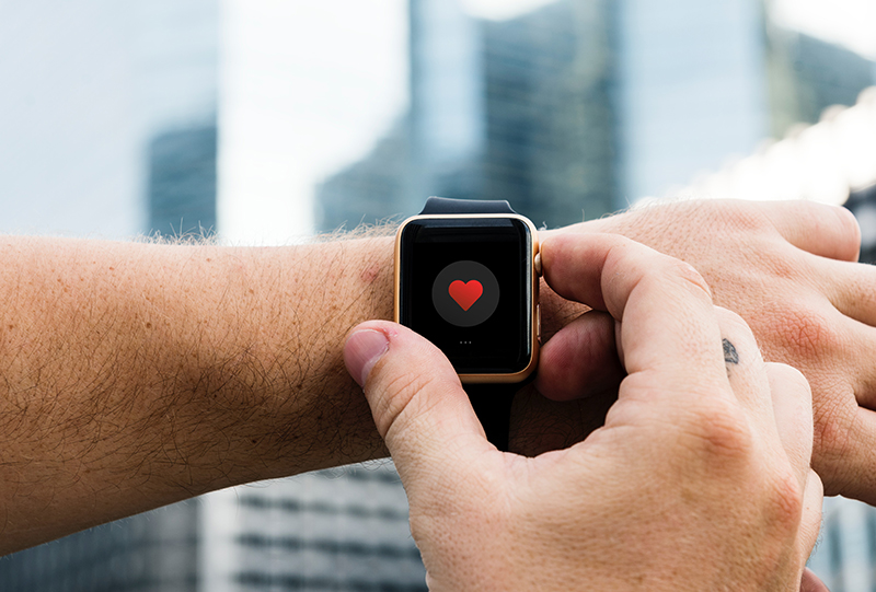 Photo of Apple Watch displaying a red heart