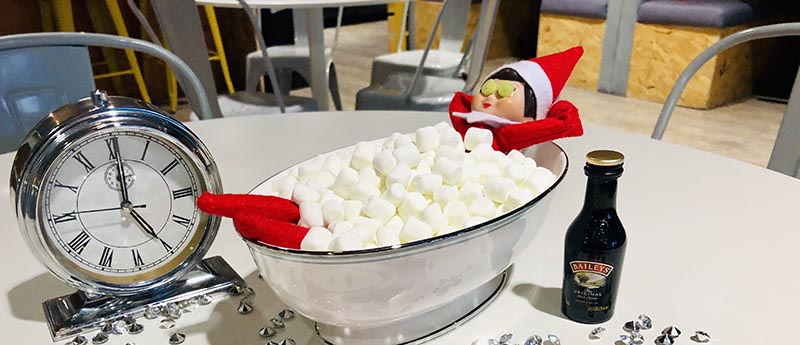 Image of Elfie the Elf in a bathtub