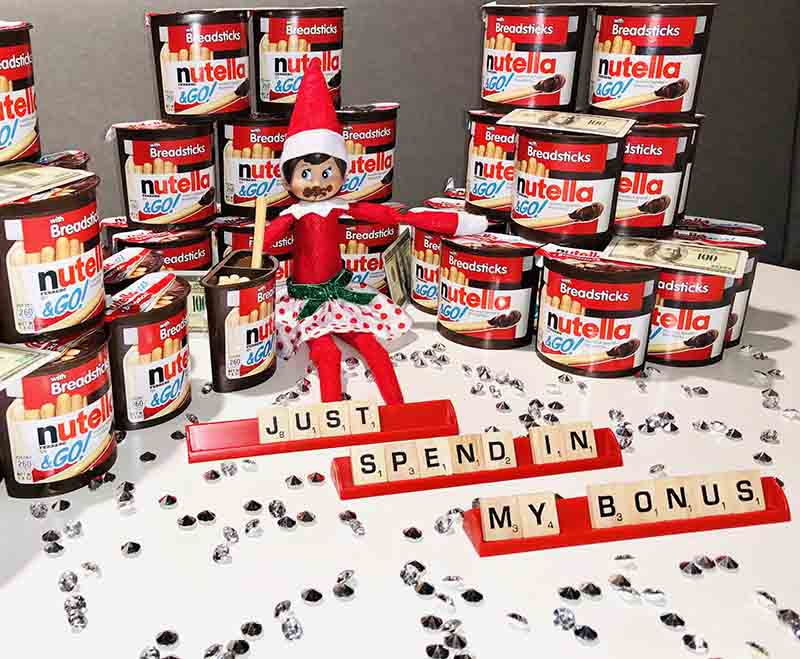 Image of Elfie the Elf with Nutella containers