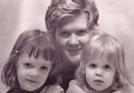 Old photo showing a mother and two daughters