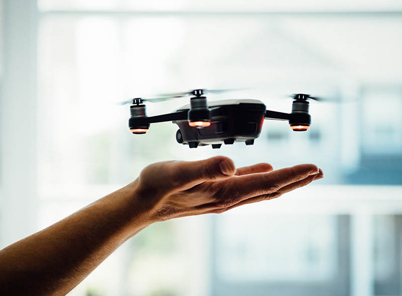 Photo of drone hovering over a man's hand