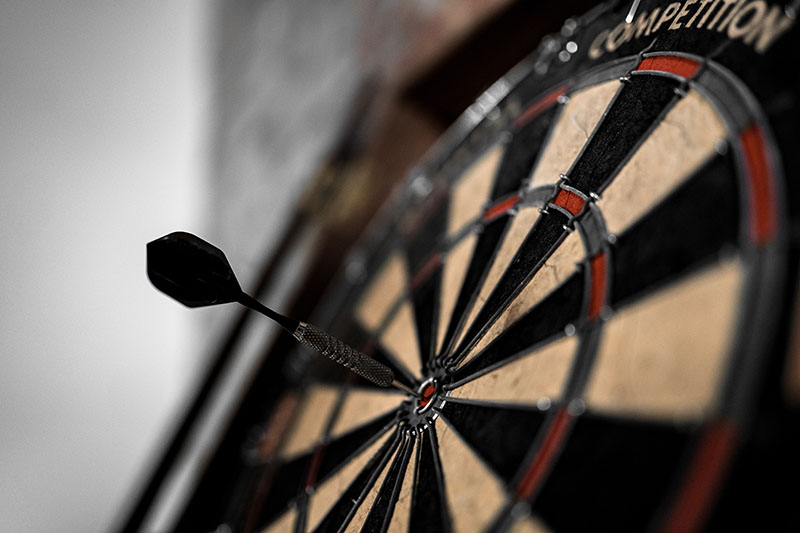 Image of dart board with dart in the bullseye