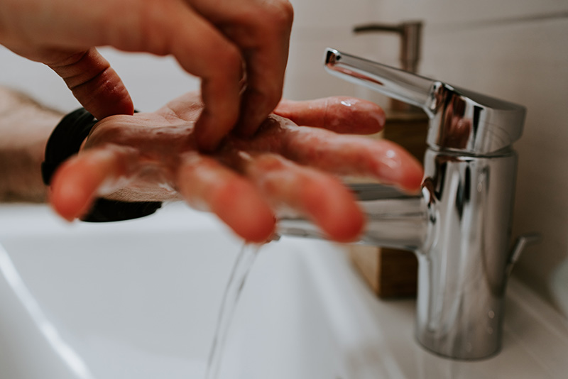 Image showing person's hands being washed