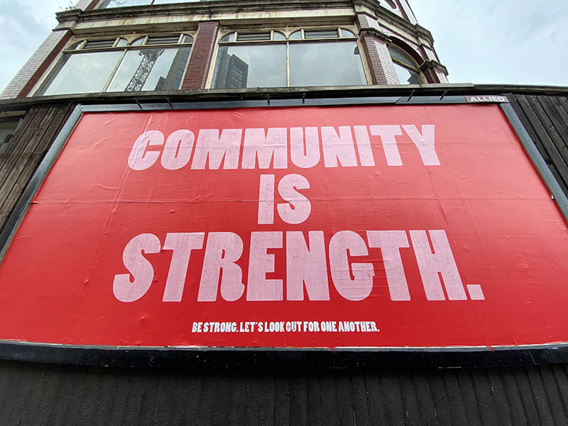 Billboard that says Community Is Strength