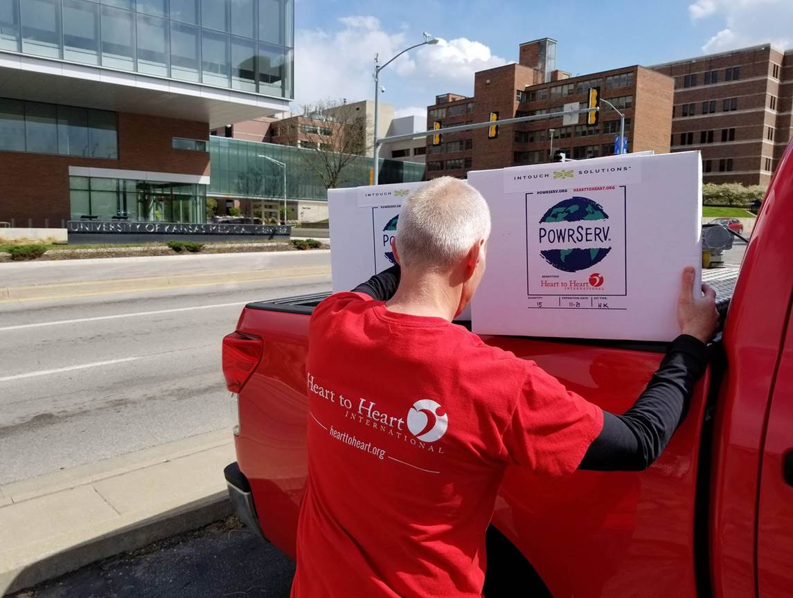 Image showing man unloading boxes from red truck
