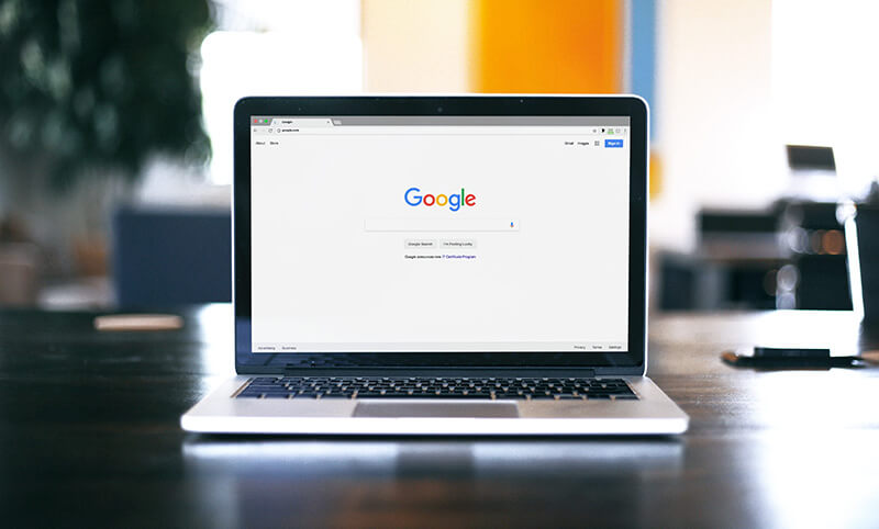 Image of laptop with Google browser on screen.