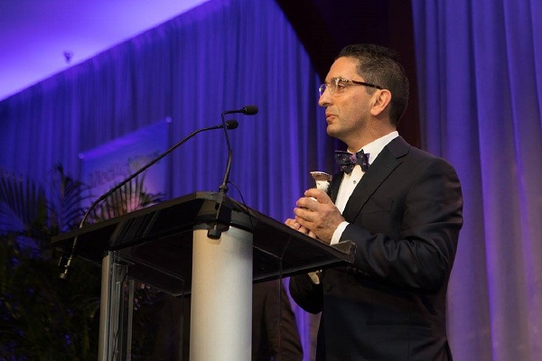 Intouch Solutions CEO Faruk Capan accepts the Heart Award